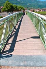 white wooden bridge in park