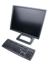 Black LCD monitor and computer keyboard