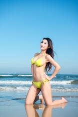 Sexy bikini model by the beach