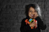 Happy Child Holding Toys Landscape