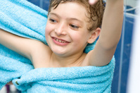 boy after bath in blue towel play