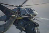 Royal Navy Sea King and Merlin Helicopter in close formation