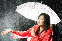 Asian women under the rain