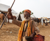 Hindu Sadhu waving cane