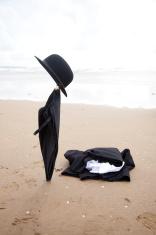 business attire abandoned on beach