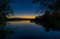 Natural lake and trees at sunrise