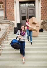 Happy Students Moving Dormitory in College University Campus Vt