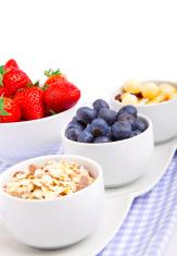 fresh blueberry, strawberry corn flakes in porcelain bowl
