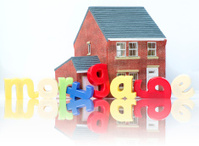 Mortgage house purchase concept with model and letters
