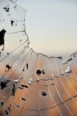 Broken dirty window glass.