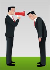 Businessman shouting to employee megaphone