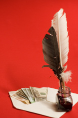 Feather quill, ink and money