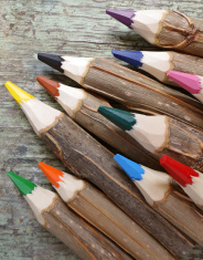 wooden pencils on weathered wood