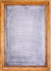 blank erased chalkboard in antique wooden frame