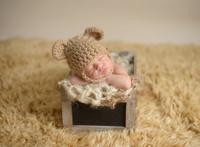 Newborn Sleeping in an Antique Crate