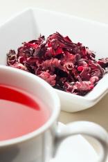 Herbal hibiscus rose-hip tea leaves and cup of tea