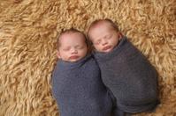 Swaddled Newborn Twin Brothers