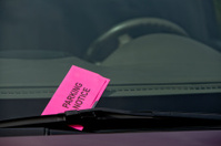 Parking Ticket Notice on Car Windshield Close Up Horizontal