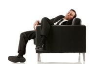 Businessman sleeping on a chair