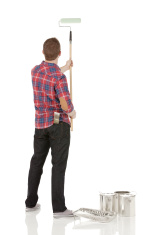 Rear view of a painter at work