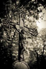 oxidized iron and greenish crucifix