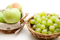 Green grapes and apple in the basket