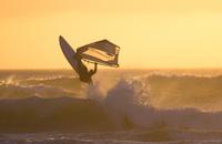 windsurfer jump sunset