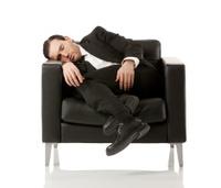Businessman sleeping in an armchair