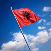 Flag of Albania against blue sky