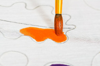painting orange ornament on silk canvas