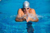 Young man at breast stroke