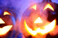 Halloween pumpkin in dark blue with spider web and smoke