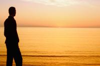 Businessman enjoying the sunrise before going to work