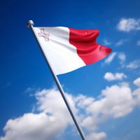 Flag of Malta against blue sky
