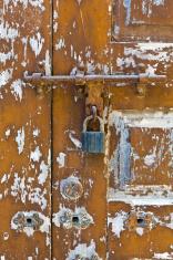 Mozambique, lock on wooden door.