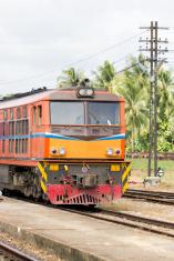 Vintage train on track at station, Thailand.