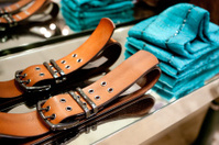 Clothes and Belts On a Rack