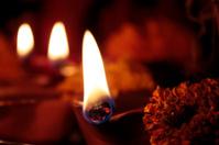 three lit earthen oil lamps(diya) on diwali