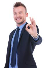 business man shows ok gesture