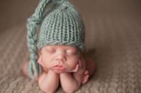 Close Up of Preemie Newborn Sleeping with Head on Hands