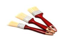 Three paintbrushes on white background