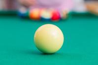 Men playing pool game...shallow DOF