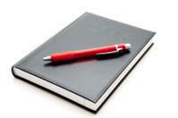 Ballpoint pen on telephone book