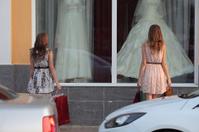 Two young women doing shopping