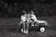 Siblings Sitting on Wagon