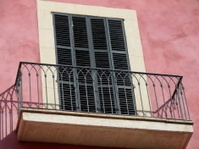 balcony with black shutters of Spanish house