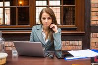 Hard working businesswoman in restaurant with laptop.