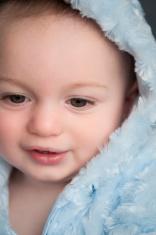 Cute baby boy with cosy hood
