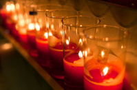 Lighted candles in a church