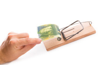 mouse trap with money (clipping path)